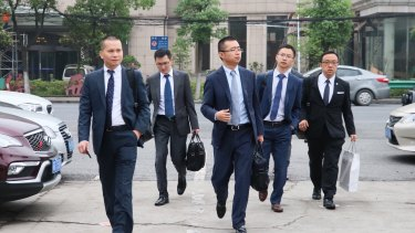 An army of lawyers arrived one by one, then in larger groups.