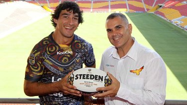Key figures … Johnathan Thurston with ARL commissioner Chris Sarra at Suncorp Stadium.