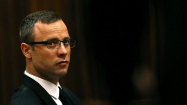 Likely to testify on Friday ... Oscar Pistorius sits in the dock prior to proceedings getting under way in court in Pretoria, South Africa.