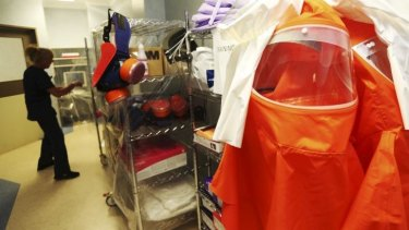 Tracey-Lee Osling, Nurse Unit Manager of Westmead Hospital's Intensive Care Unit, prepares protective equipment for the Ultra Isolation Rooms, designed specifically to manage patients with highly infectious diseases.