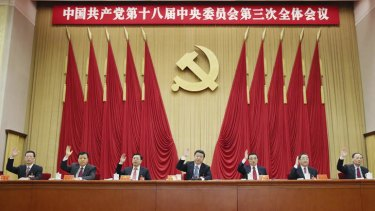 Power house: Chinese President Xi Jinping, centre, and other leaders vote during the  plenary session in Beijing.