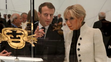 French President Emmanuel Macron and his wife Brigitte Macron visit the Louvre Abu Dhabi Museum on Wednesday.