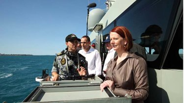 Prime Minister Julia Gillard with western Sydney MP David Bradbury visiting navy personnel on HMAS Broome in 2010.