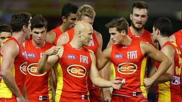 Gary Ablett talks to David Swallow during the match against North Melbourne.