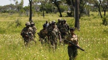 Police officers patrol near Mpeketoni after unidentified gunmen recently attacked the coastal Kenyan town.