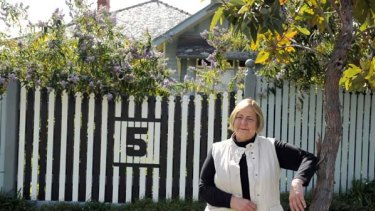 Sue McCarthy with her black-and-white fence for husband Kevin.