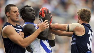 Debut looming? ... Majak Daw marks between two Geelong opponents during the NAB Cup.