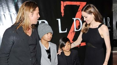 Jetsetters: Angelina Jolie with children Maddox Jolie-Pitt (left) and Pax Jolie-Pitt and partner Brad Pitt at the World Premiere of <i>World War Z</i> in London in June.