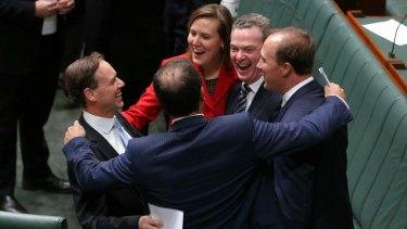 Environment Minister Greg Hunt congratulated by colleagues after Carbon Tax Repeal Bills pass the lower House.
