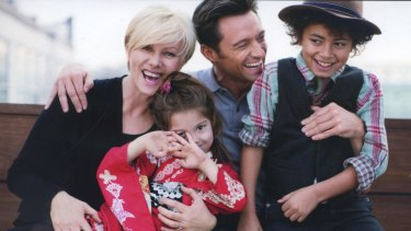 Deborra-lee Furness, pictured with husband Hugh Jackman and children Oscar and Ava, is the founder of Adopt Change.