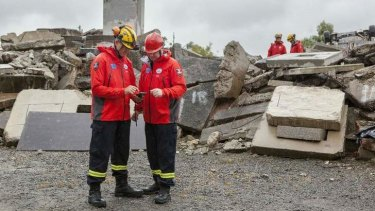 Queensland Fire and Emergency Services workers Graeme Hall and Corey Dennis at the Whyte Island training facility.