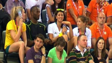 Kobe Bryant and Stephanie Rice enjoy each other's company at the velodrome.
