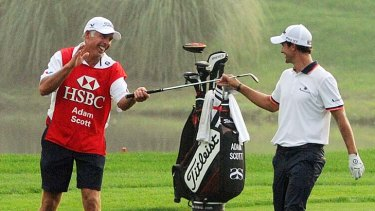 Steve Williams (left) celebrates with his new partner Adam Scott during the World Golf Championships-HSBC Champions golf tournament in Shanghai on November 5. The caddy was reported to have made up with Tiger Woods yesterday.