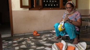 Forty-five-year-old Mala began stitching sports balls when she was 13.