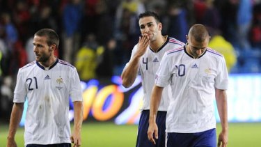 Crestfallen . . . France's Yohan Cabaye, defender Adil Rami and forward Karim Benzema leave the field after being defeated by Norway.