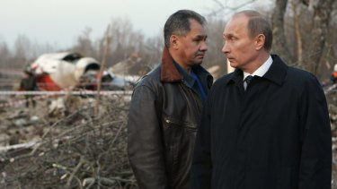 The then Russian prime minister Vladimir Putin and Emergency Situations Minister Sergei Shoigu visit the crash site of the Polish presidential plane near Smolensk on April 10, 2010.