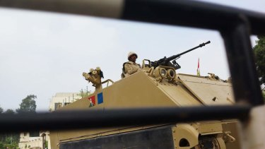 No go zone: Members of the Egyptian military stand guard at a roadblock in the district of Giza.