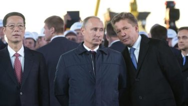 Russia's gas giant Gazprom CEO, Alexei Miller (right), Russian President Vladimir Putin and Vice Premier of the People's Republic of China Zhang Gaoli outside Yakutsk for an event to mark the start of a new gas pipeline.