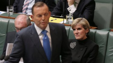 Foreign Affairs Minister Julie Bishop listens as Prime Minister Tony Abbott addresses a question about her correcting the record during question time  on Thursday.