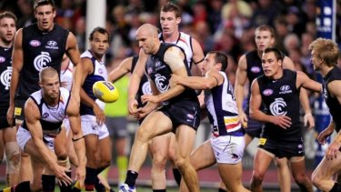 A multitude of players gather around the ball during a game between Carlton and Adelaide in 2012.