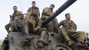 Shia LaBeouf, Logan Lerman, Michael Pena (at back), Brad Pitt and Jon Bernthal in <i>Fury</i>.