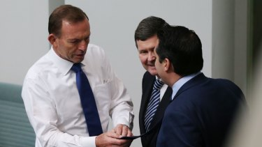 Some of the MPs describing themselves as Tony Abbott's 'deplorables'. Recently promoted Victorian MP Michael Sukkar (right) and former cabinet minister Kevin Andrews (centre) with former prime minister Tony Abbott.