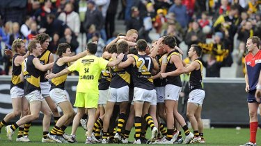 Richmond celebrate after Jordan McMahon kicked a goal after the siren to win the contentious 'tanking' game over Melbourne in 2009