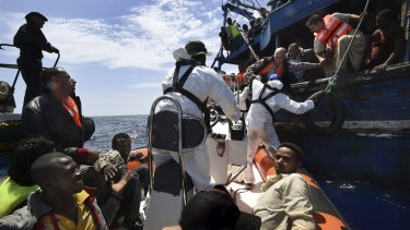 Refugees on a wooden boat carrying 565 people are rescued off the Libyan coast by Migrant Offshore Aid Station crew.