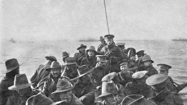 A lifeboat carrying unidentified men of the Australian 1st Divisional Signal Company being towed towards Anzac Cove at 6am on the day of the landing.