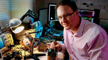 Jonathan Oxer working on his micro satellite prototype.
