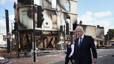 Mayor Boris Johnson walks through riot-hit Croydon.