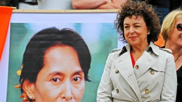 Therese Rein with a poster of Aung San Suu Kyi.
