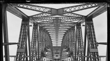 The road and underside of the arch of Sydney Harbour Bridge, from about 1932.