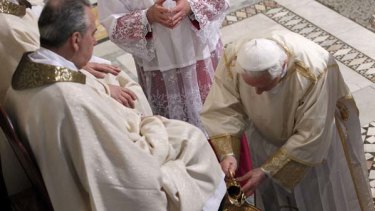 Pope Benedict XVI washes the foot of an unidentified layman in the Basilica of St John Lateran in Rome in a traditional Easter ceremony.