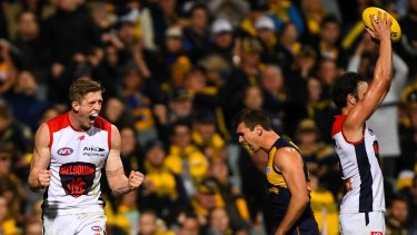 Siren song: Sam Frost celebrates the Demons drought-breaking win out west over the Eagles.