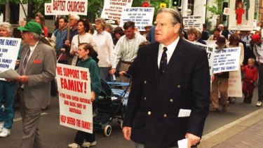 "Fred Nile has been a long-term opponent of same-sex marriage. Here he is leading supporters in a 1996 march to ""reinforce marriage between male and female""."
