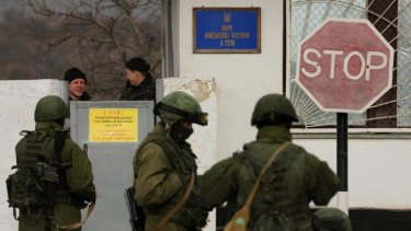 Ukrainian marines look over the wall of their military base in Perevalnoye, near Simferopol.