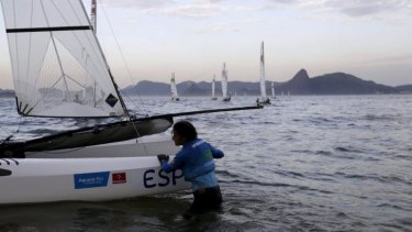 Murky waters: Spanish sailor Marina Lopez leaves Guanabara Bay after taking part in Nacra 17 class during the Aquece Rio International Regatta in Rio de Janeiro during the week. The regatta is a test event for the Rio 2016 Olympic Games.