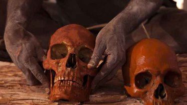 A photograph from Glenn Campbell's award-winning essay of Arnhem Land elders reburying ancestral bones, which had been held by the Smithsonian Institution in the US for 60 years.