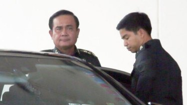 In charge: army chief and self-declared prime minister Prayuth Chan-ocha leaves Bangkok's Army Club shortly before he announced his coup on Thursday.