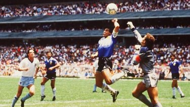 Hand of God ... Diego Maradona scores against England in the 1986 World Cup.