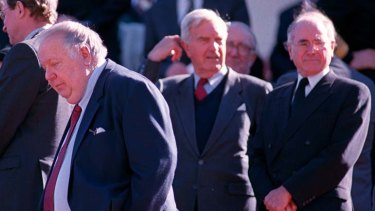 Tainted defector ... Mal Colston, left, in 1999 and the then prime minister, John Howard, right.