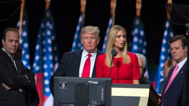 Then-Trump campaign manager Paul Manafort, right, watches with then-Republican presidential candidate Donald Trump and Manafort's chief deputy Rick Gates, left, as Ivanka Trump rehearses for the Republican National Convention in Cleveland in 2016.