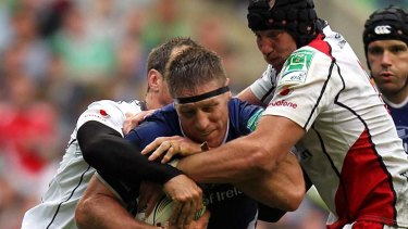Brad Thorn of Leinster crashes into the Ulster defence.