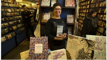 Margaret Snowdon from Readings with some of the store's adult coloring books.