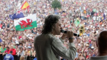 Bob Geldof, LIVE 8 organiser, invites the festival crowd to link hands in support of the Make Poverty History campaign, on the second day of the Glastonbury Music Festival in 2005.