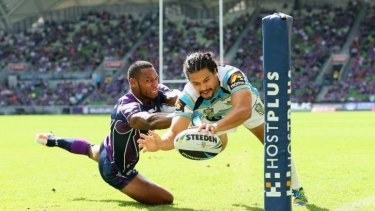 Titans winger Kevin Gordon scores in the corner despite the attention of Storm counterpart Sisa Waqa.