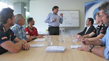Talk time: Ray McLean from Leading Teams conducts a session with, seated from left, Shannon Grant (Western Bulldogs assistant coach),  Mick Poulton (AFL Coaches Association), Jade Rawlings (Melbourne assistant coach), Adrian Anderson (former AFL football operations manager), Nathan Buckley (Collingwood) and Justin Peckett (former St Kilda player, now a Leading Teams facilitator).