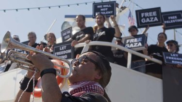 Activists aboard the Audacity of Hope, a boat which aims to sail to Gaza as part of an aid flotilla.