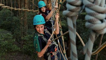 Tiptoe through the treetops … Olivia Kesteven and Angus Simpson do the high ropes course at the Baden-Powell Scout Centre, Pennant Hills.